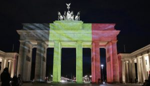 BrandenBUrg Gate in Berlin lit with the colours of the German Flag after a terrorist attack