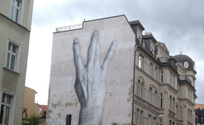 Large scale paste up Street Art Mural in Berlin Mitte
