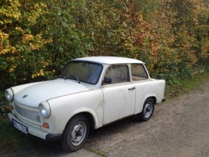 Trabant parked next to a hedge